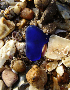 blue sea glass on pebbles